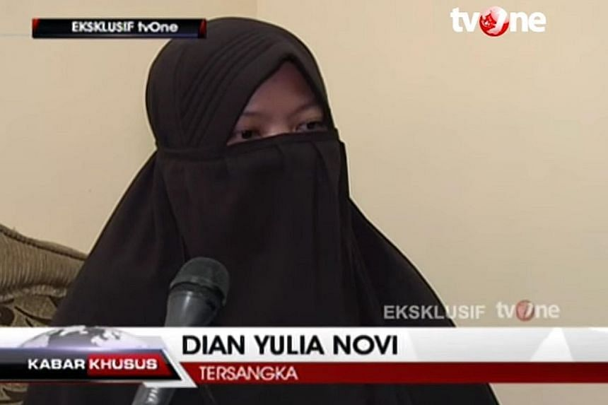 """Screen grab from a TVOne interview with Dian Yuli Novi, one of two women held over a suicide-bomb plot to strike the Jakarta presidential palace with a high-grade bomb. The woman said she had worked in Singapore for 11/2 years and was """"active"""" on Fac"""