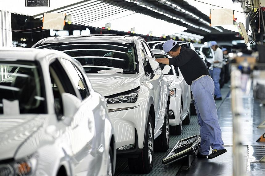Lexus vehicles on an assembly line at the Miyata Plant in Miyawaka, Fukuoka Prefecture. Auto and machinery makers' sentiment brightened in the tankan survey, which was taken days after the US presidential election last month, suggesting that sharp ye