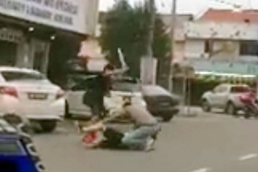 A video making its rounds online shows a Singaporean man being beaten up by three men with baseball bats in Malaysia.