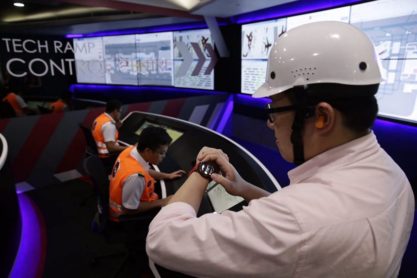 A member of the media tries out the smart watch and helmet on Dec 15, 2016.