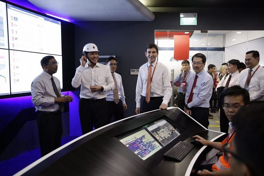 Second Minister for Transport Ng Chee Meng trying out the helmet and smart watch in the SATS Tech Ramp Control Centre on Dec 15, 2016.
