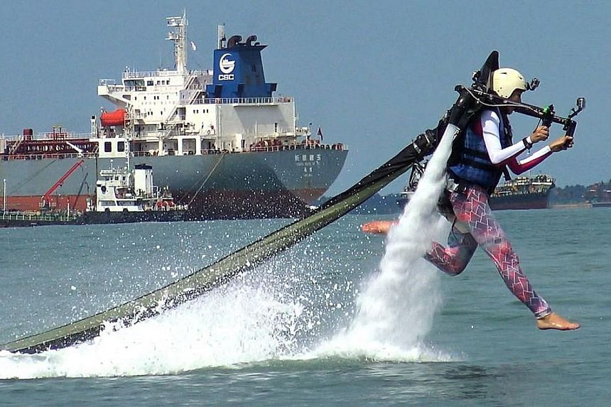 Journalist Bridget Tan piloting a 12kg jetpack, which can boost its rider up to 9m above the water.