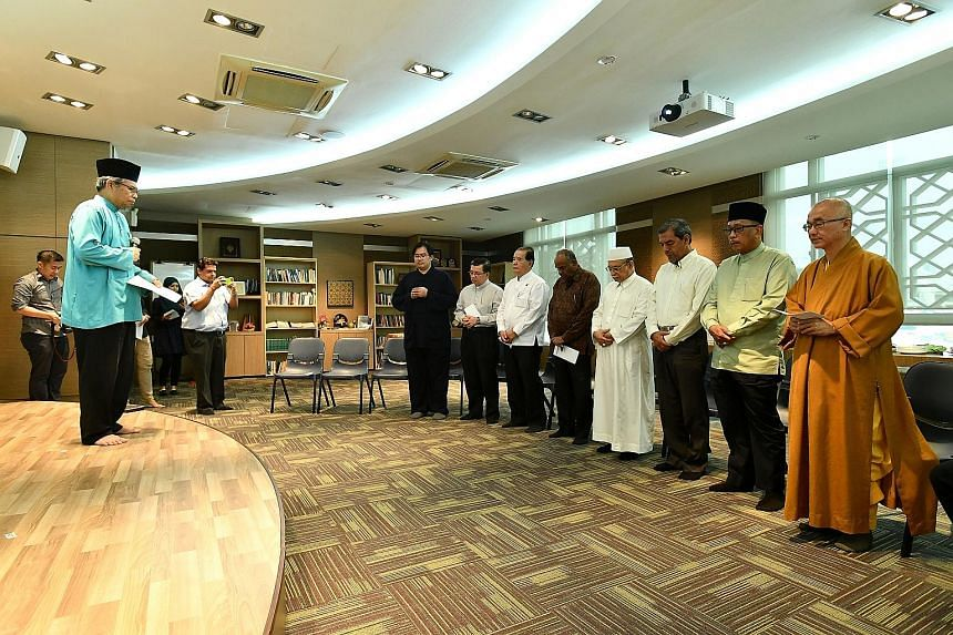 Leaders of religious groups representing multiple faiths observing a minute of silence at the Harmony Centre in Bishan yesterday. They were doing this for victims of the violence in Myanmar's Rakhine State and the earthquake that struck Aceh in Indon