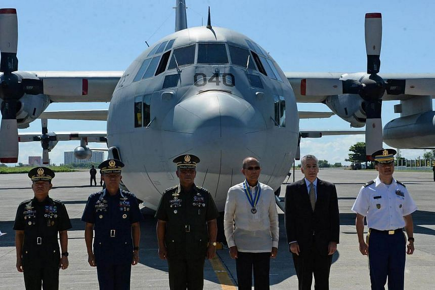 Philippine defence secretary Delfin Lorenzana (fourth from left) said the Philippines is staying out of the latest row between the United States and China over an unmanned underwater vehicle seized by a Chinese warship.