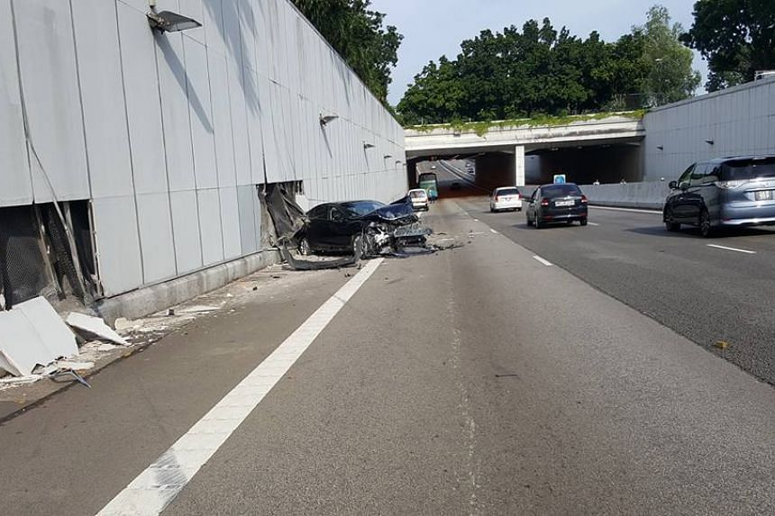 A black car was seen with a smashed bonnet and rear backed against two holes in the expressway wall.