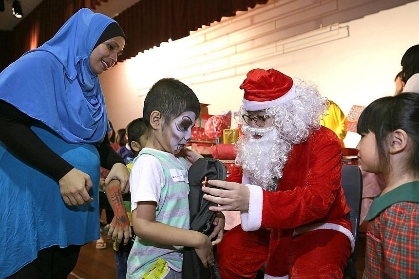 Muhamad Hussain Shah, six, received Christmas gifts for the first time on Sunday.