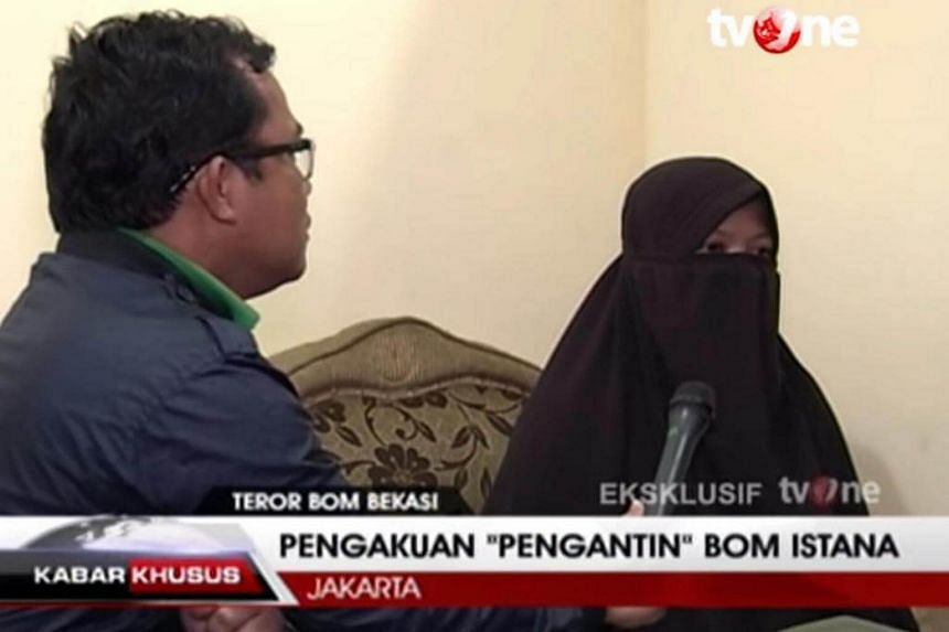 Dian Yulia Novi, 27, being interviewed on TVOne. Dian had allegedly been planning to mount a suicide bomb attack on the presidential palace in Jakarta.