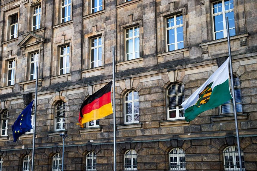 The EU flag, German flag and the state flag of Saxon are lowered to half-mast outside the state chancellery in Dresden on Dec 20, 2016.