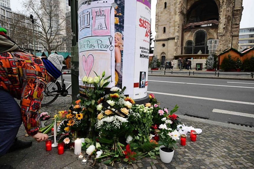 Flowers are placed at the site where a truck crashed into a Christmas market in Berlin, on Dec 20, 2016.