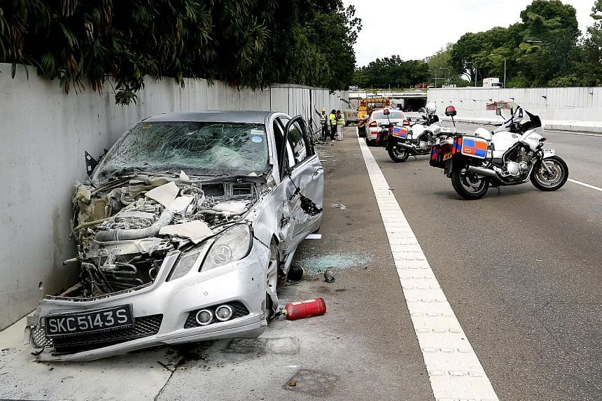 The Mercedes-Benz (left) that ploughed into oncoming traffic on the AYE, and its 53-year-old driver (right), who was arrested for causing death by a rash act.