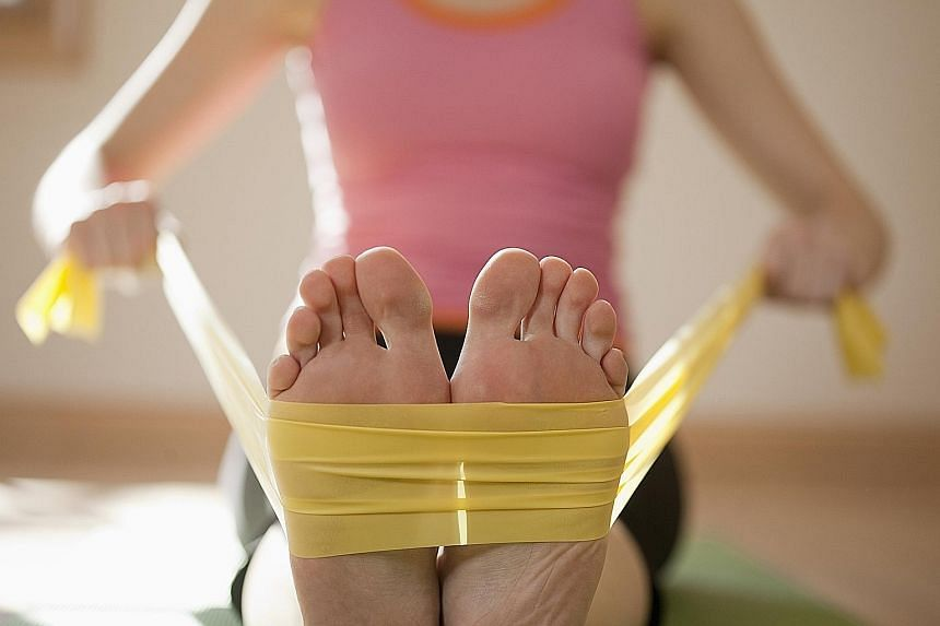 Elastic bands come in a range of resistance levels, and some come with handles and loops. They make for a good workout at home.