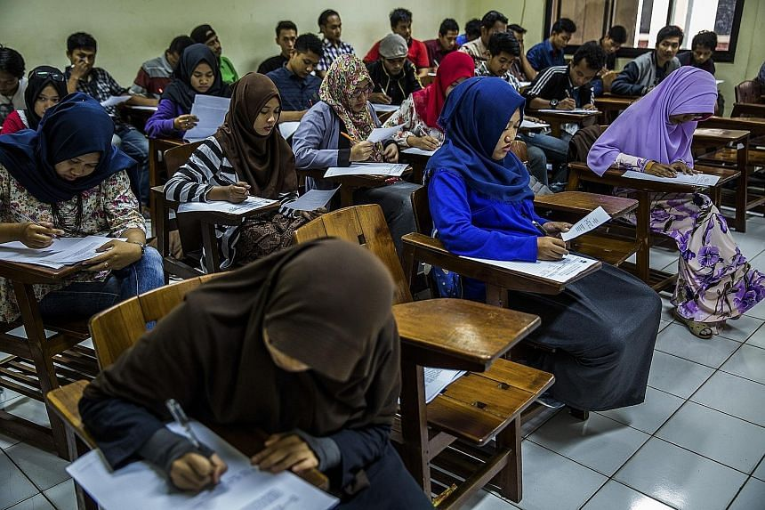 Students at Syarif Hidayatullah State Islamic University in Jakarta. A survey has found that fewer than 10 per cent of Indonesia's 250 million people have a university-level education, and of the country's six million university and postgraduate stud