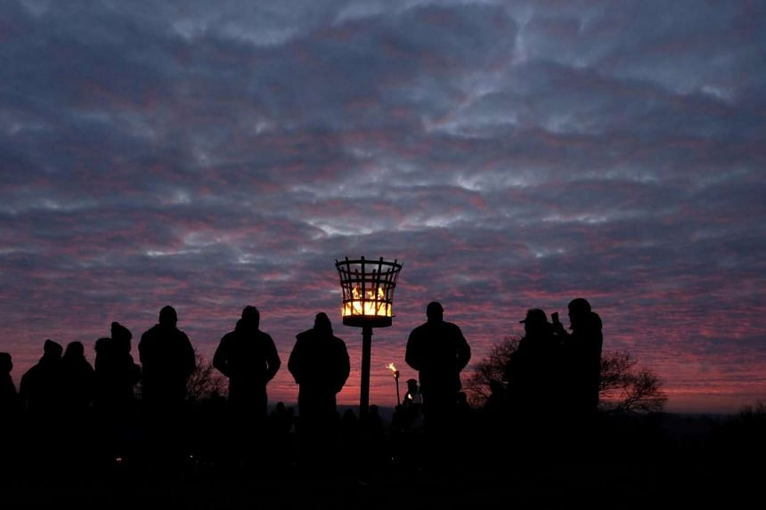 The Charnwood Grove of Druids gathering for a public winter solstice ritual on Beacon Hill near Loughborough, Britain, on Dec 18, 2016.
