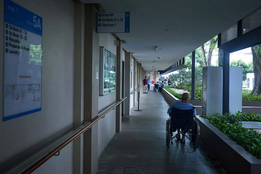 An elderly person on a wheelchair at the Pearl's Hill Care Home located on Pearl's Hill Road.
