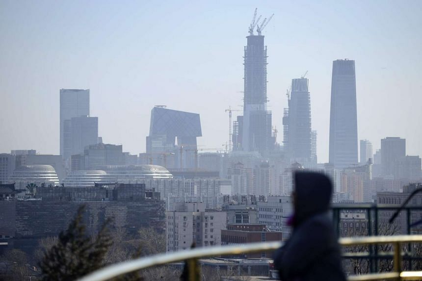 Smog covers buildings in the central business district of Beijing on Dec 22, 2016.