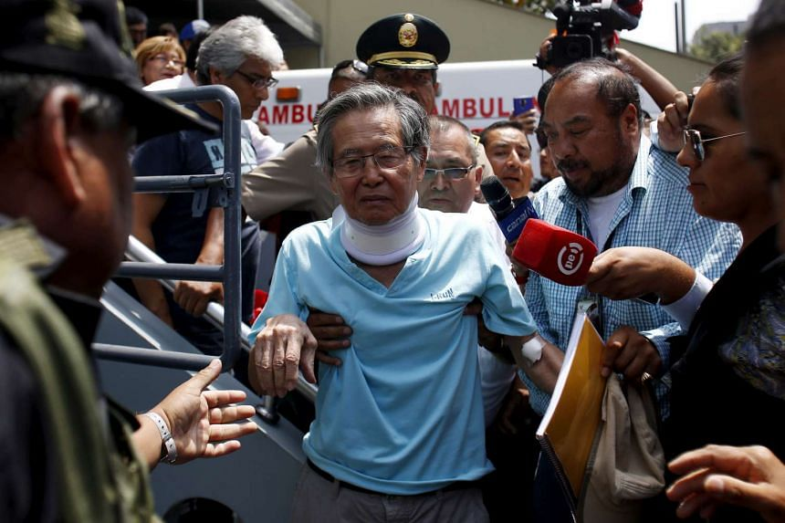 Peru's former president Alberto Fujimori leaves a clinic he was visiting from prison in March 2016.