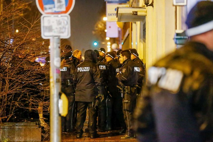 German police arrested four people who had been in contact with a Tunisian suspect in the Berlin Christmas market attack that killed 12 people, media reports said on Thursday (Dec 22), as a nationwide manhunt for the migrant was underway.