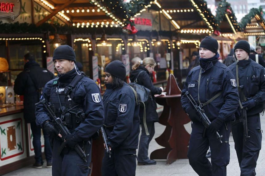 Police officers patrolling at the reopened Christmas market at Breitscheid square in Berlin on Dec 22, 2016.