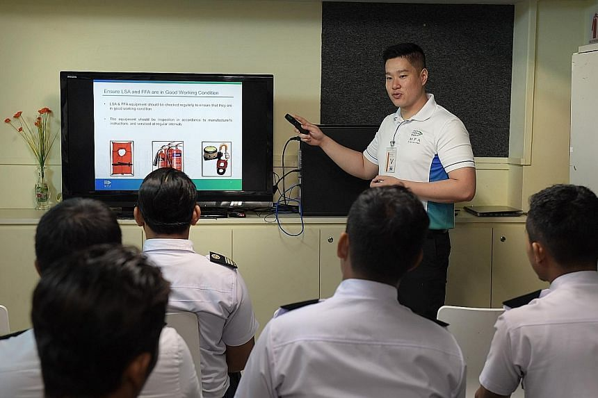 Captain Shawn Ho, 29, briefing Batam Fast crew members yesterday on safety procedures when handling their vessels.
