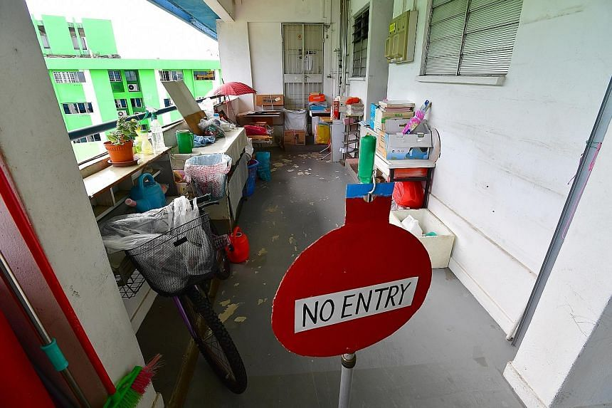 """A family has put up a """"no entry"""" sign to alert others that it has not moved out of Rochor Centre even as the Dec 30 deadline looms."""