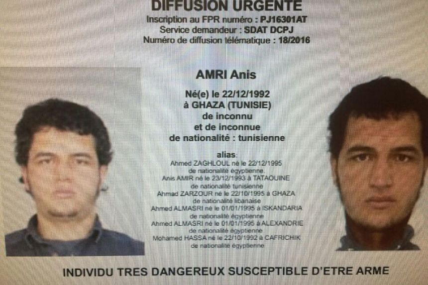 "A police record with the title, ""Urgent Distribution"" (top) and ""Very dangerous individual who could be armed"" (bottom) shows suspect Anis Amri who is sought in relation with truck attack on a Christmas market in Berlin."