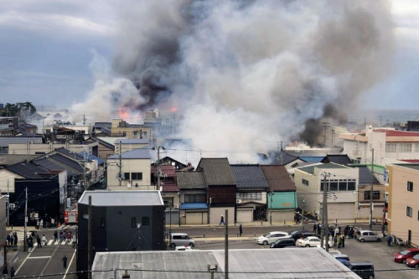 Smoke rising from a fire that broke out in Itoigawa, Niigata prefecture, on Dec 22, 2016.