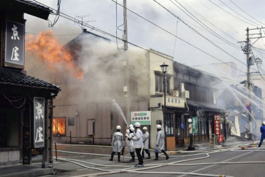 Firefighters spraying water on a fire that broke out in Itoigawa, Niigata prefecture, on Dec 22, 2016.