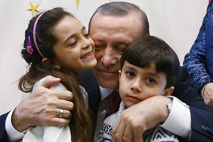 Seven-year-old Bana al-Abed and her brother met Turkish President Recep Tayyip Erdogan on Tuesday at the presidential palace in Ankara, after she was evacuated from Aleppo under a deal brokered by Turkey and Russia.
