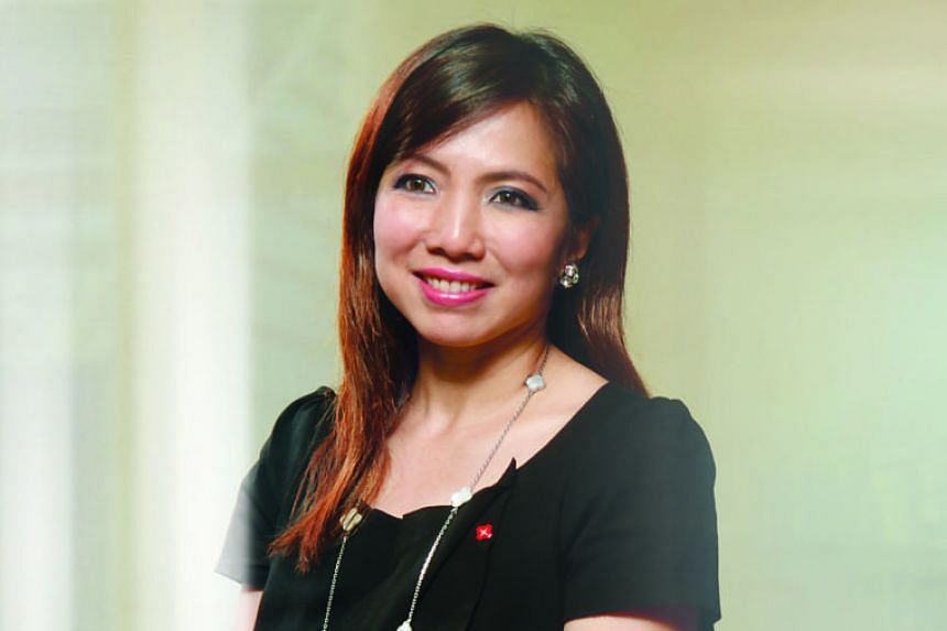 MS TAN SU SHAN , DBS' group head of consumer banking and wealth management.