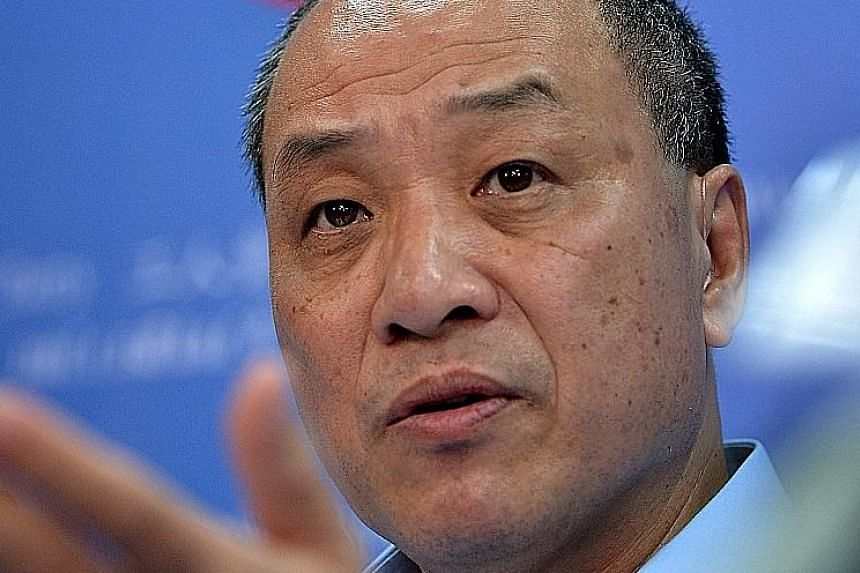 Workers' Party chief Low Thia Khiang (top) could face serious competition from Mr Chen Show Mao (above) at the party's next internal election.