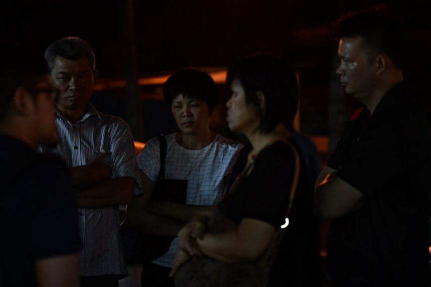 Relatives of Singapore permanent resident Au Poh Kiew, who was one of four women from Singapore who died on Dec 24, 2016, when a bus plunged off the North-South Expressway near Muar in Johor.