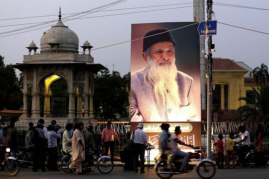 """A portrait of Mr Edhi on display in Lahore on July 9 after his death. When asked why he was prepared to help people from all faiths, without prioritising Muslims over others, his response was """"because my ambulance is more Muslim than you""""."""