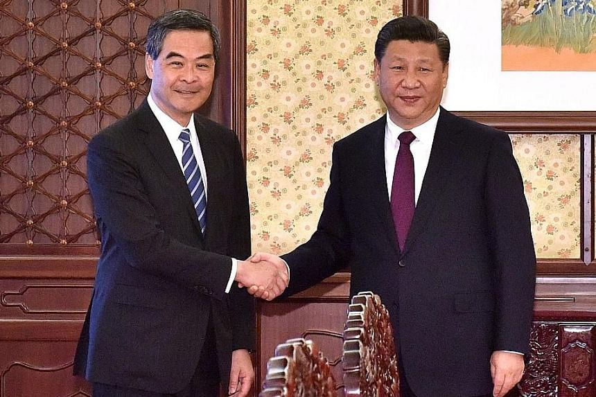 Outgoing Chief Executive Leung Chun Ying (on the left) with Mr Xi in Beijing yesterday. The Chinese President said he respected Mr Leung's decision not to stand for re-election and praised him for his work, such as curbing moves by some to promote in
