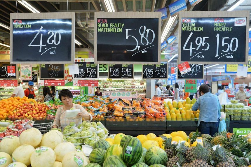 Shoppers at the fruit section in NTUC FairPrice Xtra.