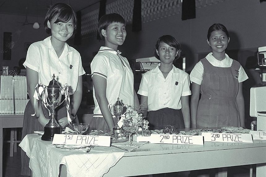 Winners of an Eat More Wheat cooking competition in 1968 held at Raffles Girls' School.