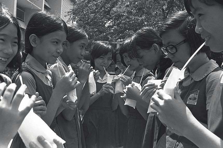 Students of River Valley Secondary School drinking milk in 1974, part of a subsidised scheme by the Education Ministry for about 27,000 students.