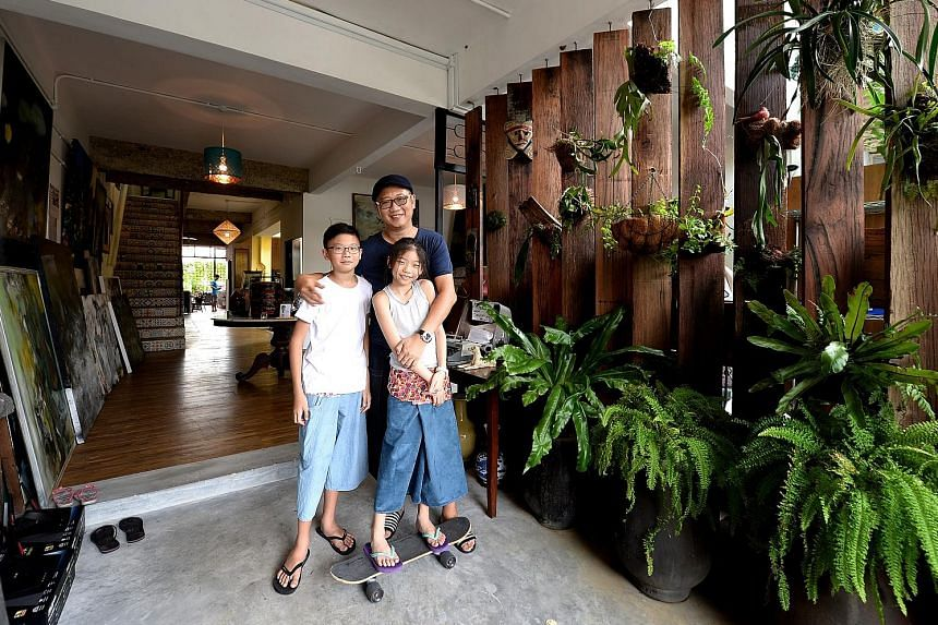 Mr Calvin Soh with his son Dylan and daughter Ava. Mr Soh thinks the Pisa rankings are evolving too slowly and cannot catch up with the exponential pace at which technology is developing. He has set up One Kind House, a community space with an urban