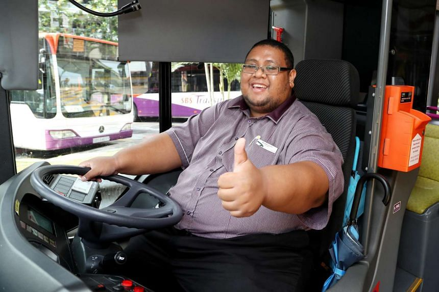 SBS Transit bus captain Kamarul, 29, has been driving for about a year. He often stands between the bus and bus stop with an umbrella to shelter those without one during rainy days.