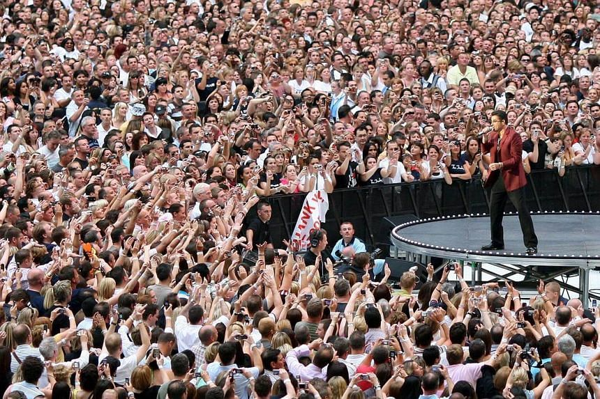 British pop singer George Michael performing during his 25 Live concert at the Wembley Stadium in London, on June 9, 2007.
