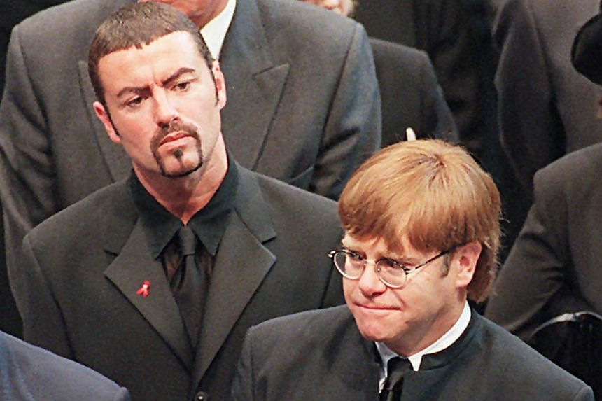 Pop stars George Michael (left) and Elton John (right) leaving Westminster Abbey following the funeral service of Diana, Princess of Wales, on Sept 6, 1997.