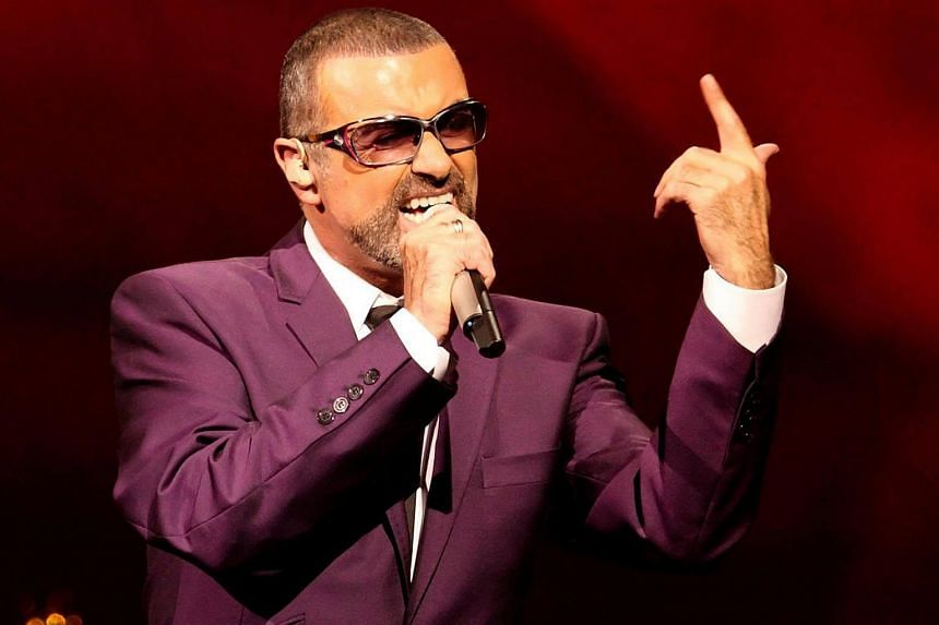 British singer George Michael performing on stage during his Symphonica tour concert in Vienna on Sept 4, 2012.