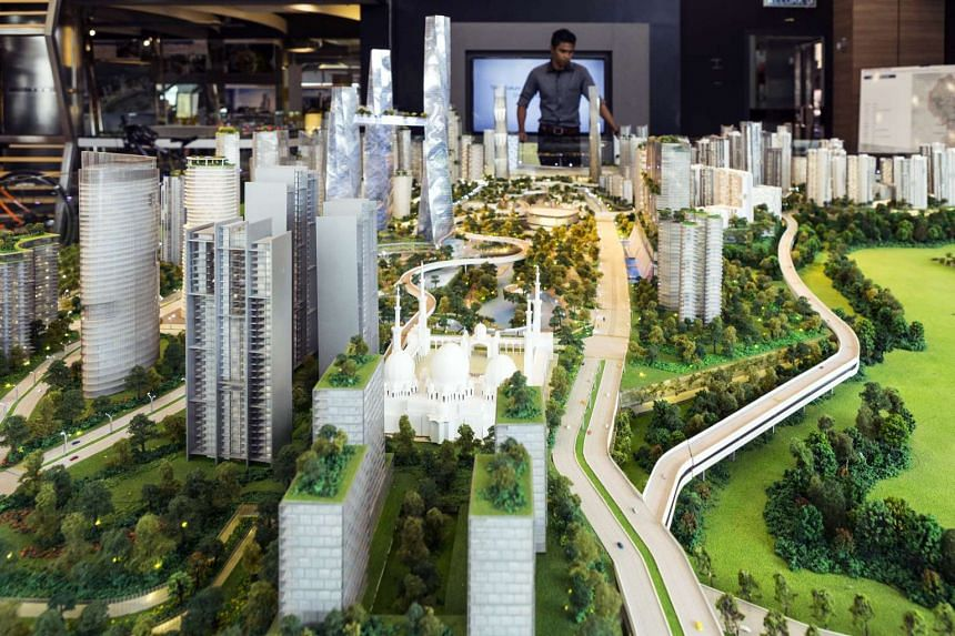 A visitor looks at a model of the proposed Bandar Malaysia development which will host terminals for a planned high-speed rail line connecting Kuala Lumpur to Singapore.