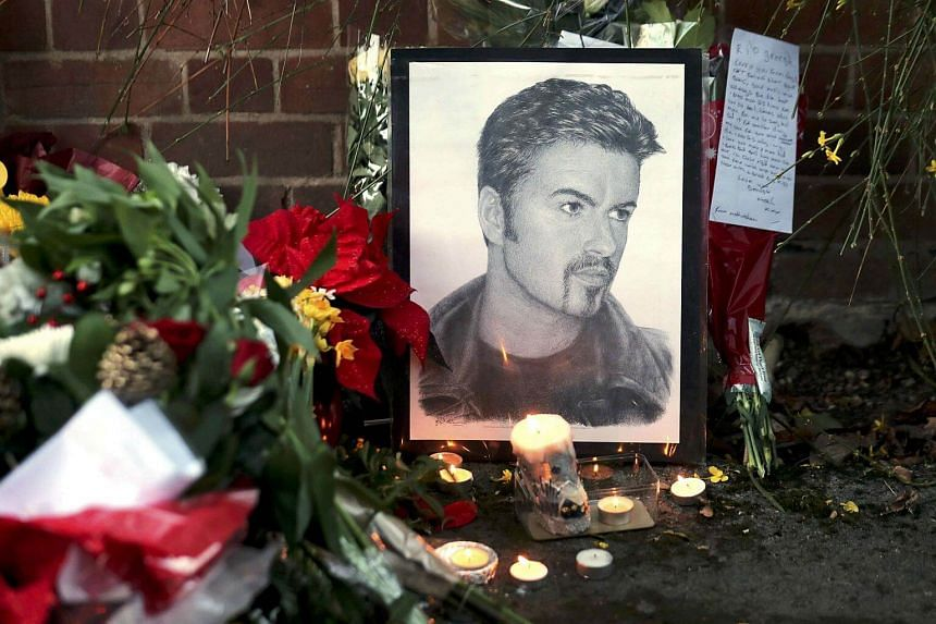 Tributes are seen outside the house of singer George Michael, where he died on Christmas Day, in Goring, southern England, Britain, on Dec 26, 2016.