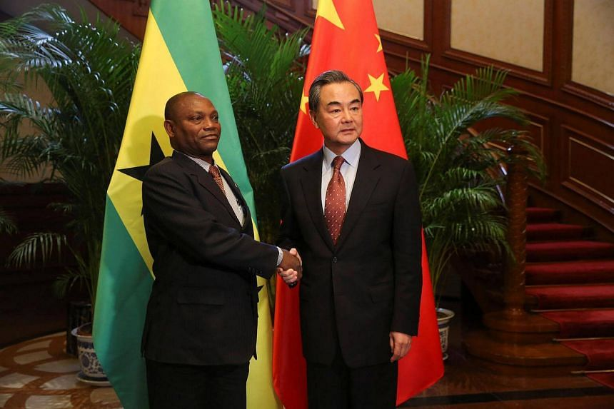 China's Foreign Minister Wang Yi and Sao Tome and Principe's Foreign Minister Urbino Botelho attend a signing ceremony for China and Sao Tome and Principe to establish official relations, in Beijing, China, on Dec 26, 2016.