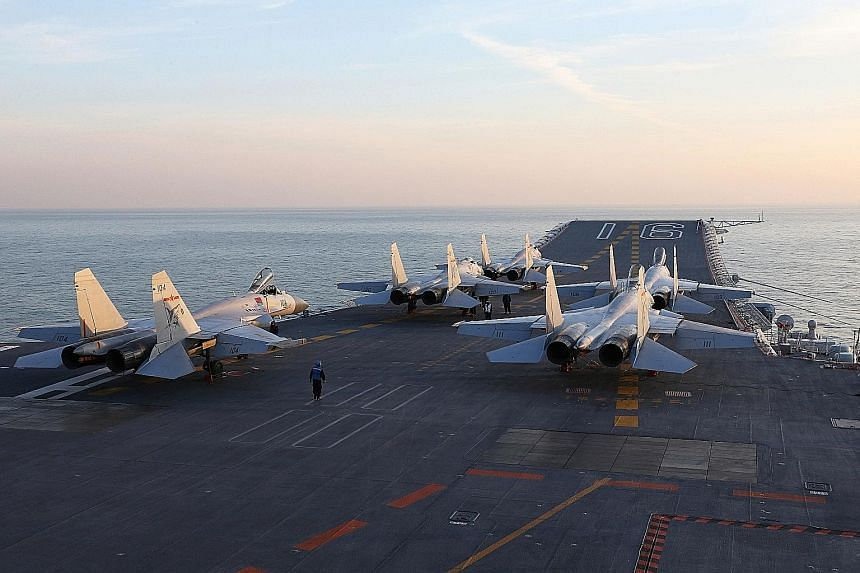 Chinese J-15 fighter jets on the Liaoning aircraft carrier during military drills in the Bohai Sea, off China's north-east coast, earlier this month. The vessel and five other warships on Monday passed the Taiwan-administered Dongsha Islands in the S