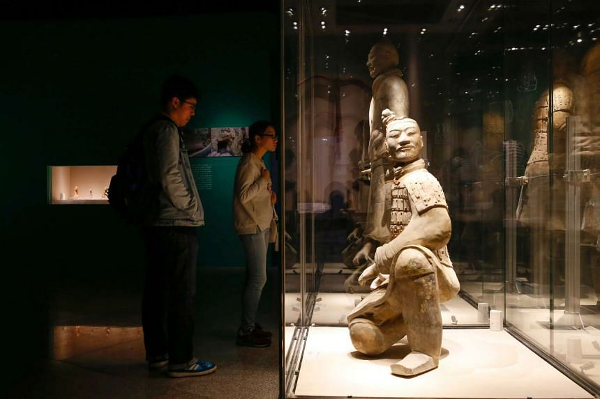 Visitors looking at terracotta warriors on display at the Terracotta Warrior Museum in Xi'an, Shaanxi province, on Oct 21, 2016.