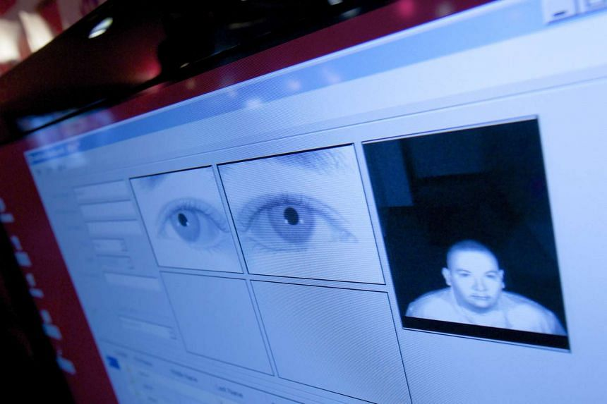 The scan of an eye is displayed on a computer screen. The ICA will begin collecting iris images from Singapore Citizens and Permanent Residents from Jan 1.
