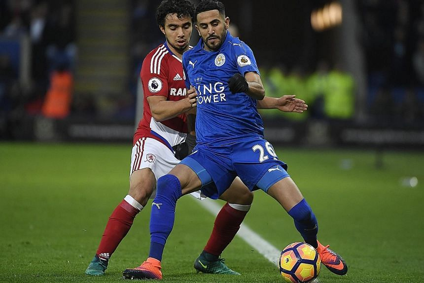 Leicester's Riyad Mahrez shielding the ball from Middlesbrough's Fabio Da Silva during a Premier League game last month. The Algerian has not yet adjusted fully to the new system of play, as the team struggle to stay clear of the relegation zone.