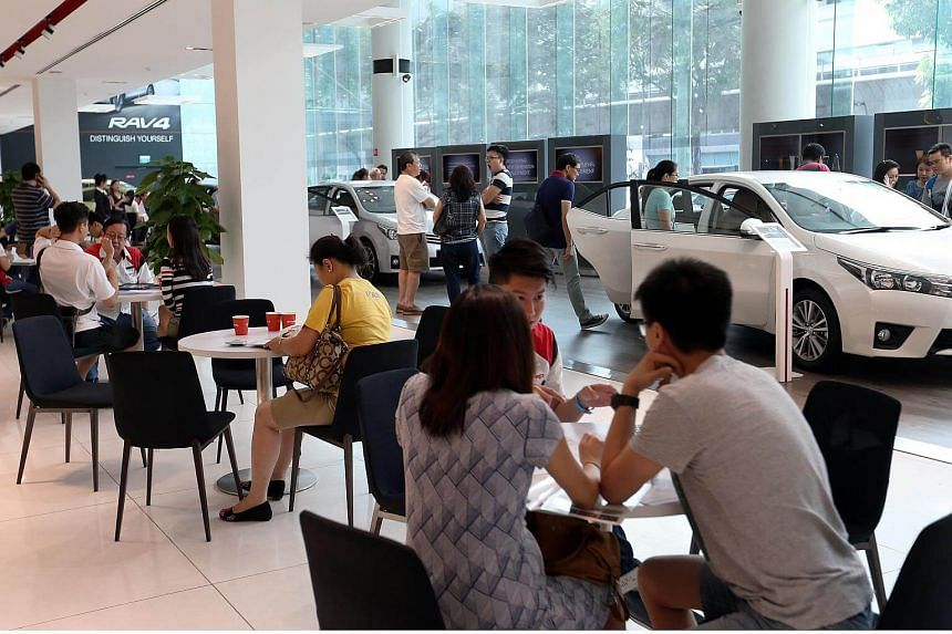 Potential car buyers at Borneo Motors' Leng Kee Showroom, on May 29, 2016.