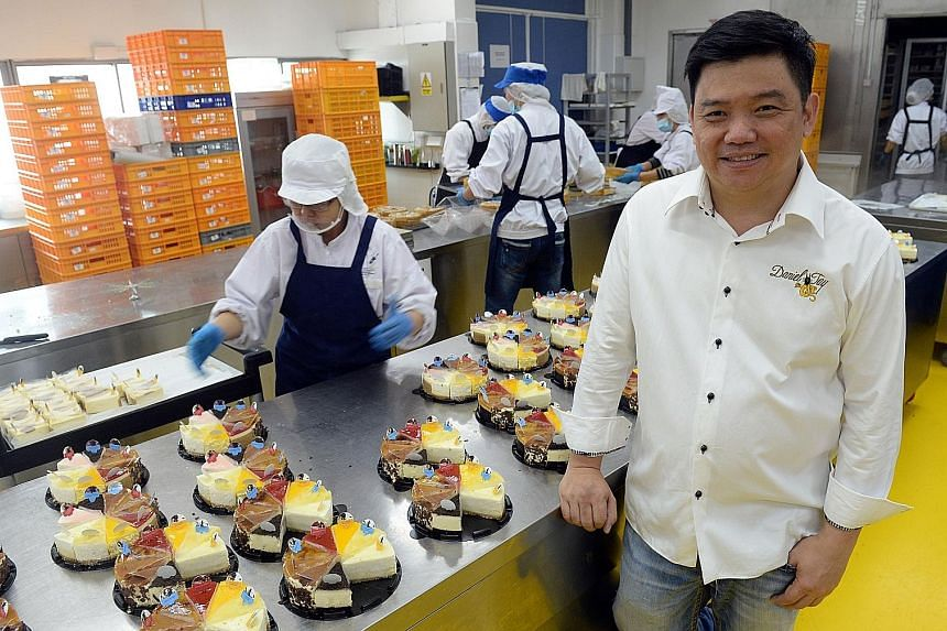 """Mr Daniel Tay, founder and head chef of cheesecake business Cat & the Fiddle, has pumped about $650,000 into equipment enhancement this year. """"The future is about technology and advancement, it's not going to U-turn and go primitive. You have to put"""